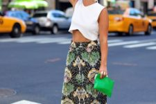 08 a tropical print midi skirt, a white crop top, statement earrings and shoes for a wow look