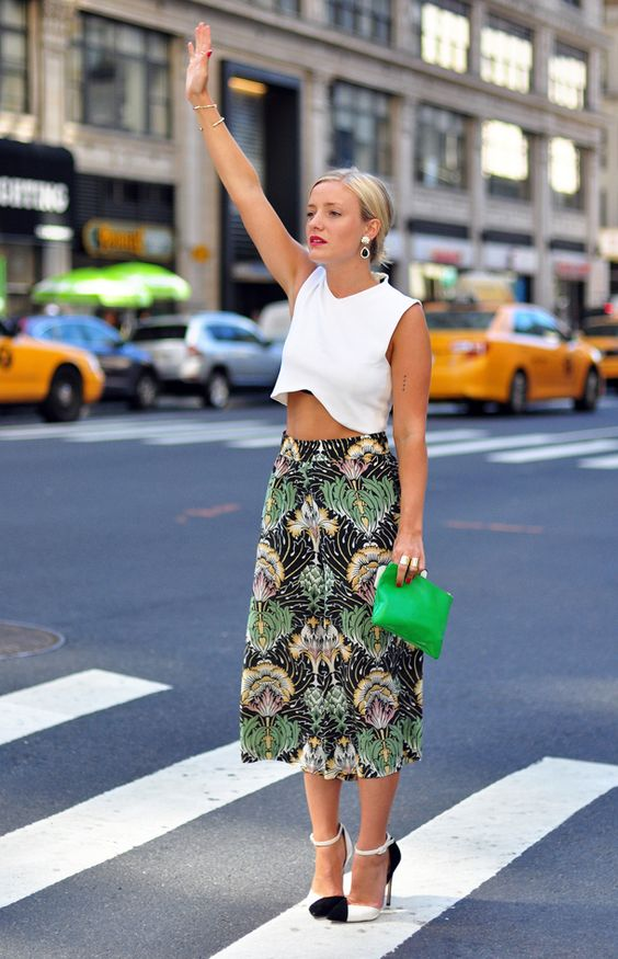 a tropical print midi skirt, a white crop top, statement earrings and shoes for a wow look