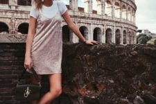 08 a white tee, a blush velvet slip, white sneakers and a black bag for a trendy look