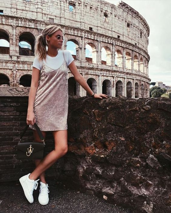 a white tee, a blush velvet slip, white sneakers and a black bag for a trendy look