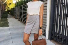 08 a white top, a grey asymmetrical mini skirt, lavender flats and a brown bag
