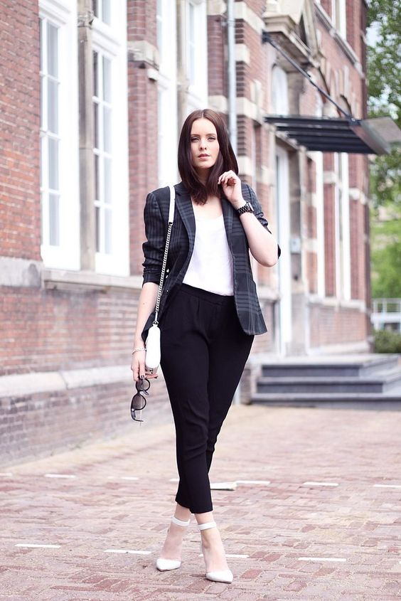 a white top, a plaid blazer, white ankle strap shoes and black pants for a cool look