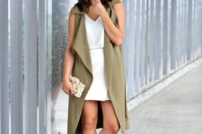 08 a white top, a white wrap mini skirt, white heels, a printed clutch and an olive green duster vest