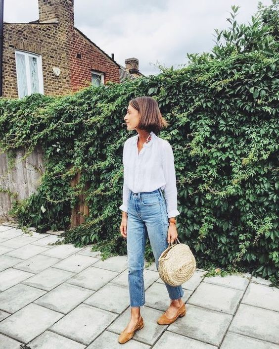 blue cropped jeans, a white shirt,tan shoes and a straw bag for the transitional time