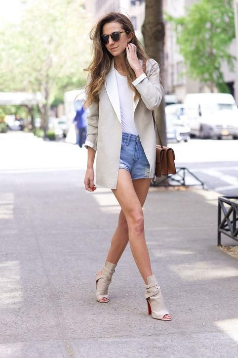 blue denim shorts, a white tee, an off-white jacket, off-white booties and a bag