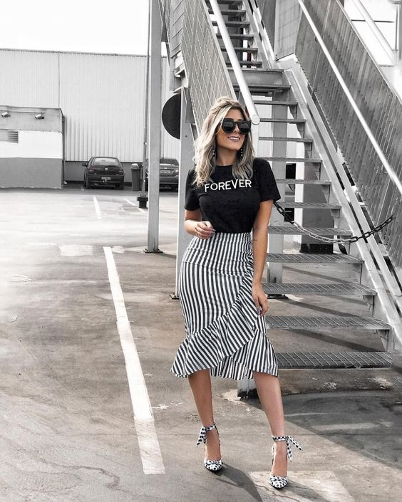 a black tee, a striped ruffled midi skirt, polka dot strappy heels