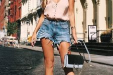 09 a blush spaghetti strap top with buttons, denim shorts, floral mules, a small bag