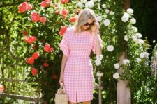 09 a cute pink and white plaid knee dress with short sleeves, blush lace up heels and a straw bag