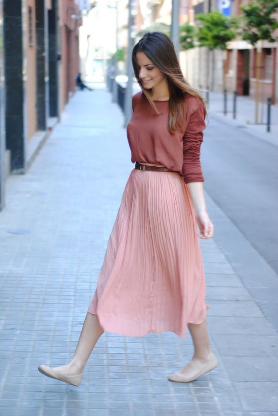 a pink pleated midi skirt, a muted burgundy long sleeve, nude flats for a simple look
