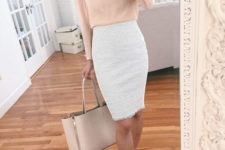 09 a white pencil knee skirt, a blush ruffled blouse with long sleeves, a blush bag and heels