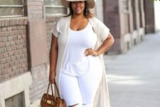 09 a white tee, white jeans are spruced up with a camel bag and sandals plus an off-white hat and vest