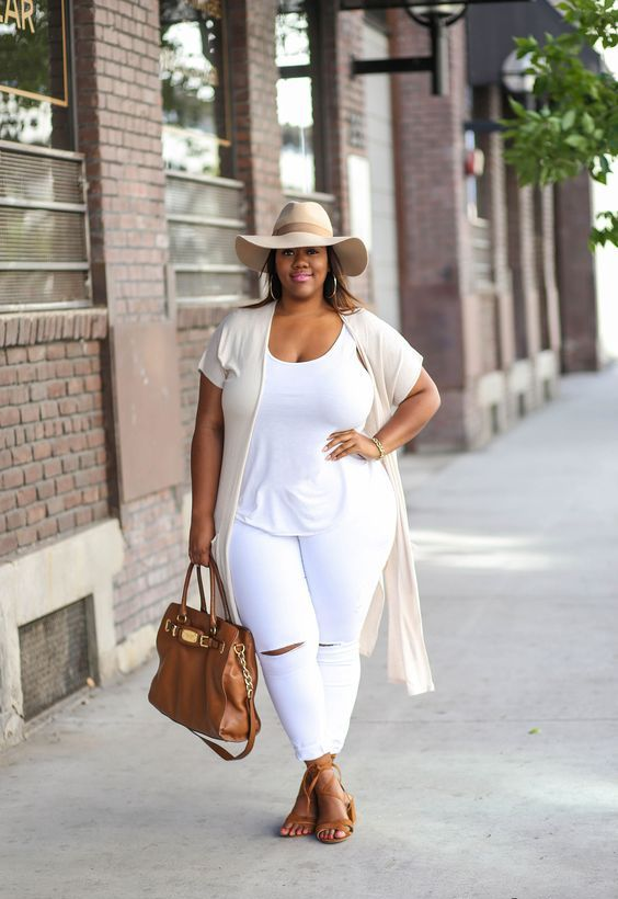 a white tee, white jeans are spruced up with a camel bag and sandals plus an off white hat and vest