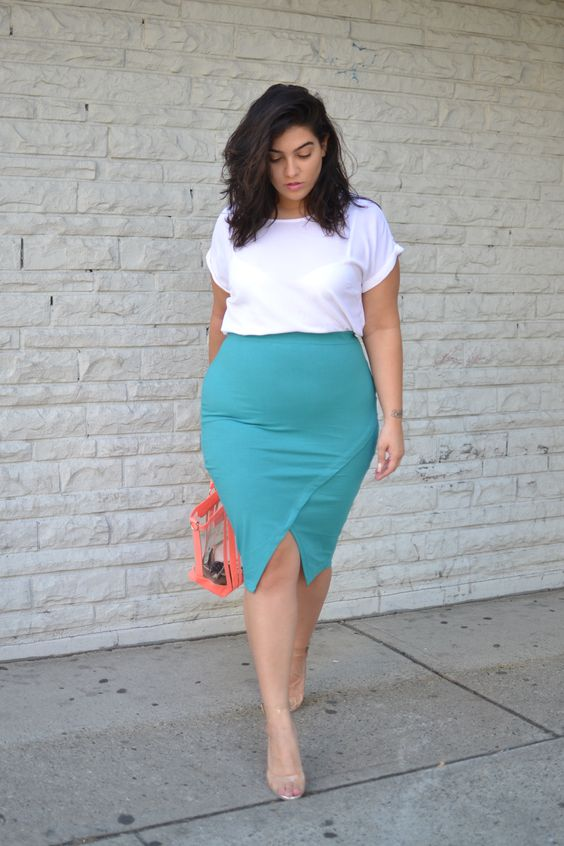 an asymmetrical teal pencil skirt, a white tee, nude shoes and a sheer bag