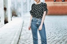 09 cropped blue jeans, a black and white polka dot shirt with ruffled sleeves and neutral mules