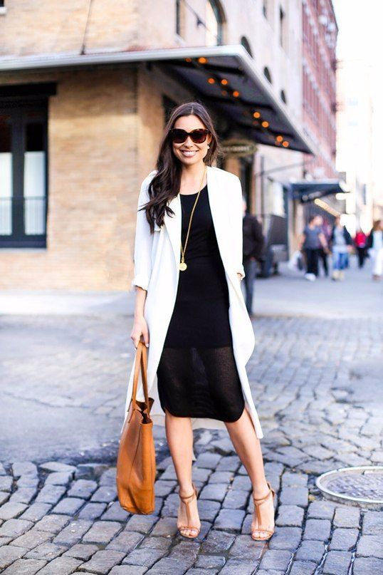 a black dress with a partly shee skirt, a white duster, tan shoes and a tan bag for work