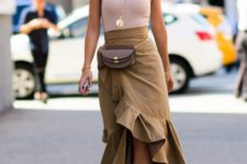 10 a black top, a beige ruffled asymmetrical midi skirt, nude shoes and a waist bag