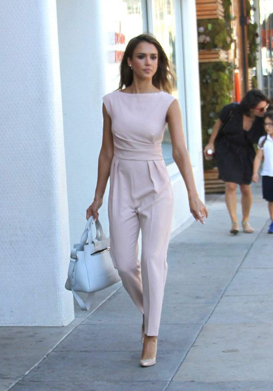 a pink sheath jumpsuit that highlights every curve and looks office-appropriate at the same time