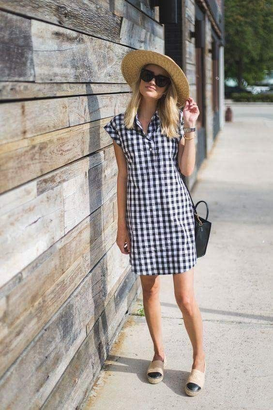 a plaid mini shirtdress, slipons, a hat and a black bag for an effortless look