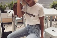 10 a white Wrangler t-shirt, high waisted blue jeans and trendy sunglasses