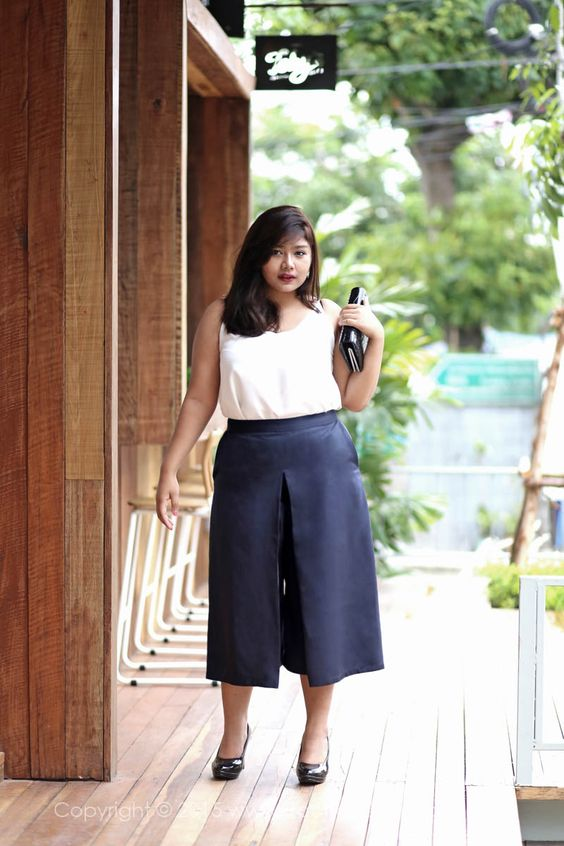 a white spaghetti strap top, black culottes, black heels and a clutch to go to work