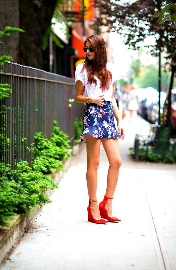 a white tee, a navy floral mini skirt and red ankle strap wedges for a sexy feel