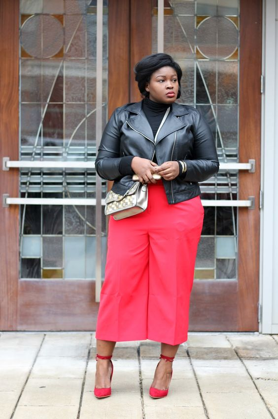 a black turtleneck, red culottes and shoes, a black leather jacket for a bright fall look