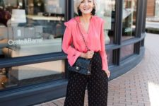 11 a creative work look with a pink blouse with ruffled sleeves, black printed culottes, nude shoes and trendy earrings
