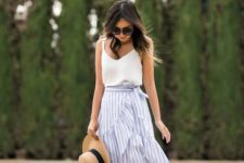 11 a summer look with a white spaghetti strap top, a black and white ruffle knee skirt, tan shoes and a hat