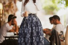 11 a white long sleeve, a full navy floral skirt and white sneakers