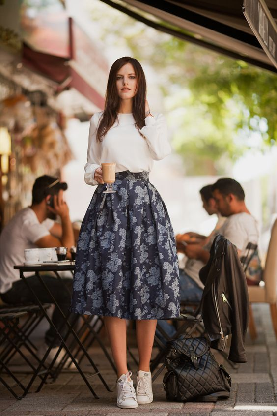 a white long sleeve, a full navy floral skirt and white sneakers
