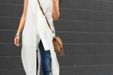 11 a white sleeveless top, a white duster vest, ripped blue jeans and white heels for transitional time