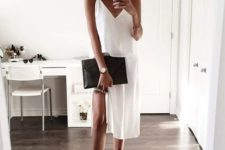 11 a white slip dress, black lace up shoes and a black clutch for a chic minimalist look