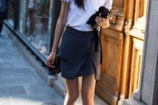 11 a white tee, a graphite grey asymmetrical skirt, black shoes and a bag for a work look