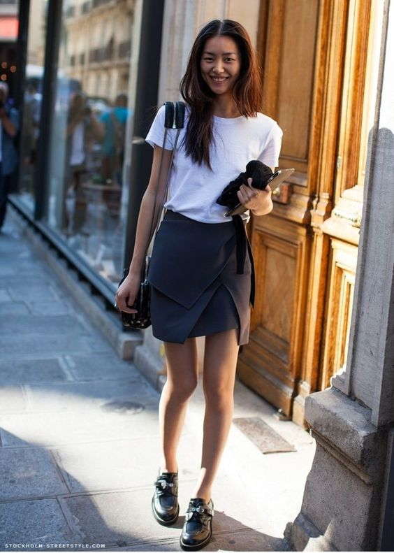 a white tee, a graphite grey asymmetrical skirt, black shoes and a bag for a work look