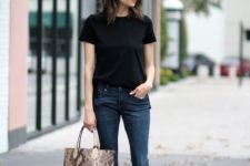 11 cropped navy flare jeans, a blakc tee, lace up shoes and a printed bag