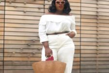 relaxed all white look with a straw bag