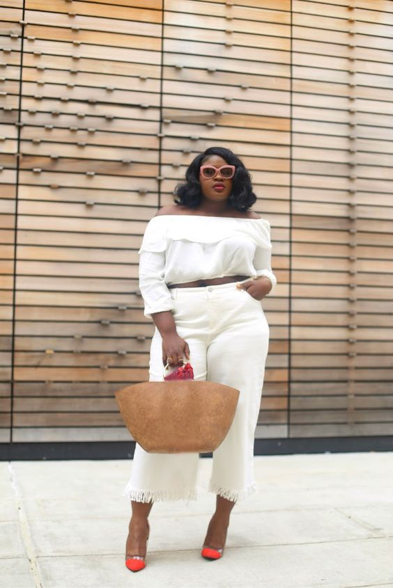 short fringed white jeans, an off the shoulder crop top, bold shoes and a straw bag