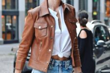 11 wear blue denim shorts, a white shirt and a brown leather jacket for a wow effect