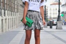 12 a Celine white t-shirt, a graphic mini skirt, colorful shoes and a grene clutch