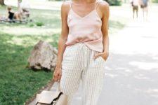 12 a blush spaghetti strap top, striped pants, a neutral bag