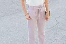 12 a pastel work look with a ruffled sleeve top, light pink pants and shoes