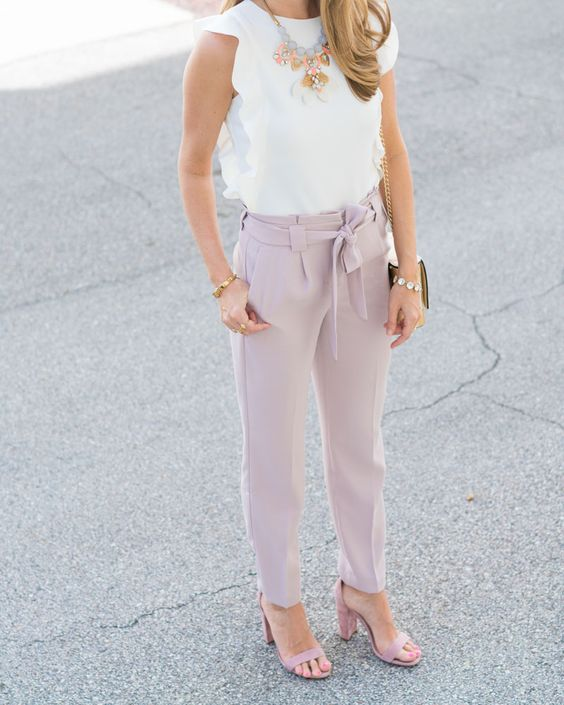a pastel work look with a ruffled sleeve top, light pink pants and shoes