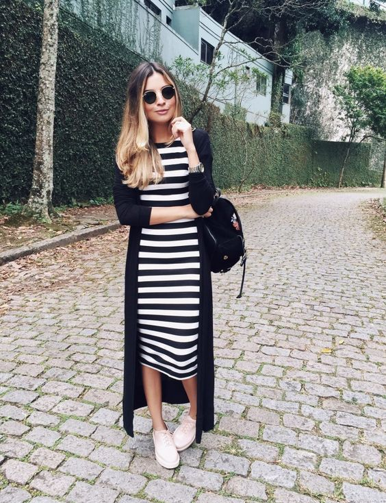 a striped bodycon midi dress, a long black cardigan, a black backpack and blush sport shoes