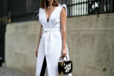 12 a stunning look with a black jumpsuit and a white long vest with a deep neckline plus heels