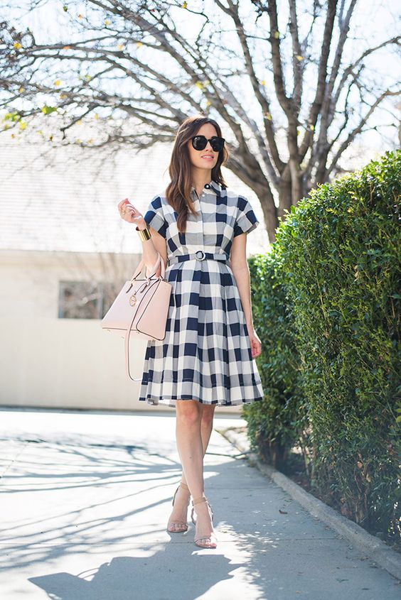 a vintage inspired blue, grey and white plaid dress with short sleeves and a blush bag to wear to work