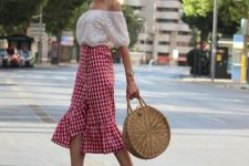 12 a white off the shoulder top, a red gingham midi ruffle skirt, nude shoes and a wicker bag