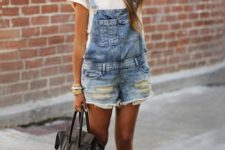 12 a white tee, a denim ripped overall, printedflats and a black bag for a casual look