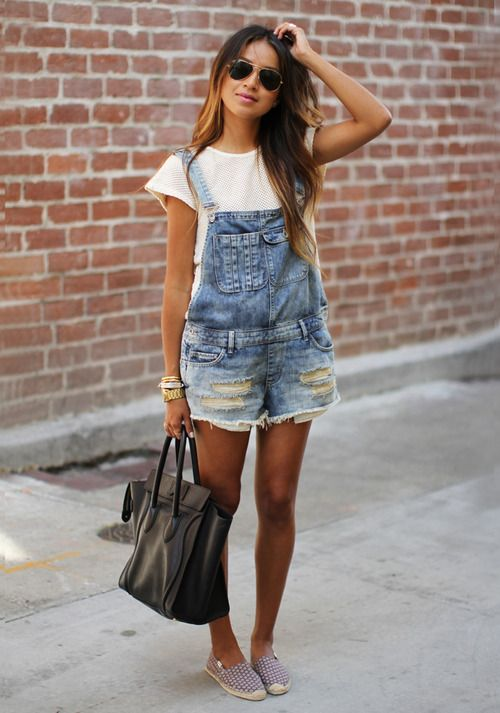 a white tee, a denim ripped overall, printedflats and a black bag for a casual look