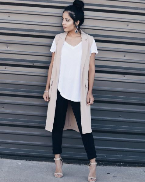 a white tee, black skinnies, a nude duster vest and nude heels for a casual look