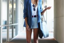 12 a white tee, blue shorts with a colorful sash, white sneakers and a blue jacket